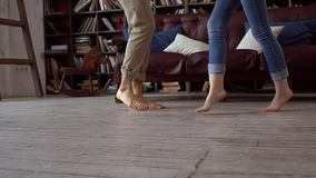 Young couple at home together saint valentine`s day concept at library dance movement. Young couple at home together saint valentine`s day in the library dance stock video footage