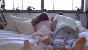 Young couple at home together saint valentine`s day concept falling down on bed fun. Young couple at home together saint valentine`s day walking to bed together stock video