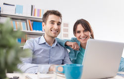 Young couple at home using a laptop Stock Image
