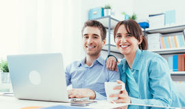 Young couple at home using a laptop Royalty Free Stock Images