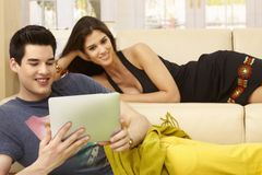 Young couple at home using tablet computer Royalty Free Stock Photo