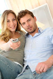 Young couple at home watching tv Royalty Free Stock Photo