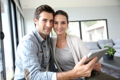 Young couple at home websurfing Royalty Free Stock Photo