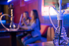 Young couple in a hookah bar. Royalty Free Stock Photos