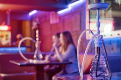 Young couple in a hookah bar. Royalty Free Stock Photo