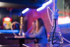 Young couple in a hookah bar. Royalty Free Stock Photography