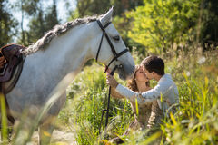 Young couple with horse Stock Image