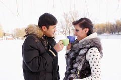 Young couple with a hot drink Royalty Free Stock Photography
