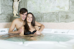 Young couple in the hot tub Stock Photo