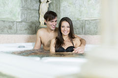 Young couple in the hot tub Stock Photos