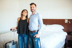 Young couple on a hotel room Royalty Free Stock Images