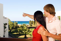 Young couple on hotels terrace. Happy young couple on hotels terrace stock image