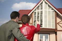 Young couple and house Stock Images