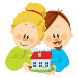 Young couple with house in hands Stock Photo