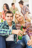 Young Couple At House Party Stock Images