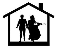 Young couple in the house silhouette. Stock Photography