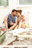 Young couple in house under construction Stock Photo