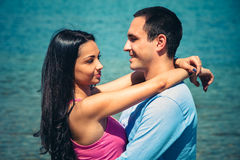Young couple in hug Stock Images