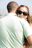 Young Couple Hugging. Closeup Portrait Of A Cute Couple Hugging , Focus On Female royalty free stock photos