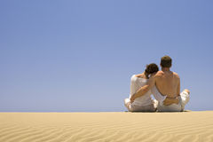 Young couple hugging. On the dunes in Gran Canaria royalty free stock photo