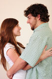 Young couple hugging. And looking at each other stock image