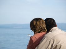Young couple hugging. Couple hugging, sea in the background Royalty Free Stock Photos