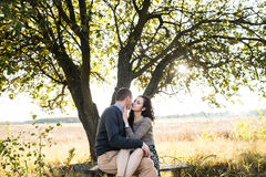 Young couple hugging at autumn sunset Stock Image