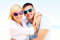 Young couple hugging at the beach. A picture of a young romantic couple hugging at the beach Royalty Free Stock Photography