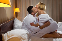 Young couple hugging on the bed Stock Image