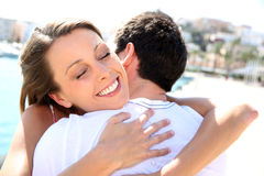 Young couple hugging being happy Royalty Free Stock Images