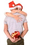 Young Couple hugging and Christmas Present Royalty Free Stock Photography