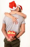 Young Couple hugging and Christmas Present Stock Photo