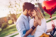 Young couple hugging dating and kissing outdoor. Young couple in love hugging dating and kissing outdoor Royalty Free Stock Photography