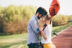 Young couple hugging dating and kissing outdoor. Young couple in love hugging dating and kissing outdoor Stock Images