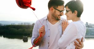 Young couple hugging dating and kissing outdoor. Young couple in love hugging dating and kissing outdoor Stock Photography