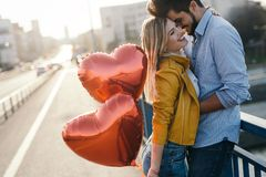 Young couple hugging dating and kissing outdoor Stock Photography