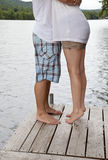 Young Couple Hugging on Dock Royalty Free Stock Photo