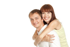 Young couple hugging each other. Portrait of a beautiful young  smiling couple hugging each other. Isolated on white Stock Photos