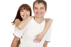 Young couple hugging each other. Portrait of a beautiful young  smiling couple hugging each other. Isolated on white Stock Image
