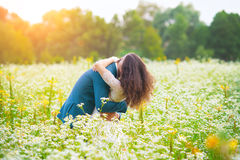 Young couple hugging in the field Stock Image