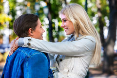 Young couple hugging and flirting in autumn park. Royalty Free Stock Photography