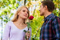 Young couple hugging and flirting in  park. Stock Photo