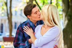 Young couple hugging and flirting in  park. Royalty Free Stock Images