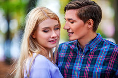 Young couple hugging and flirting in  park. Royalty Free Stock Photography