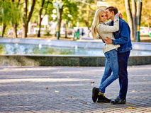 Young couple hugging and flirting in  park Stock Photography