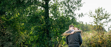Young couple hugging in a forest Royalty Free Stock Image
