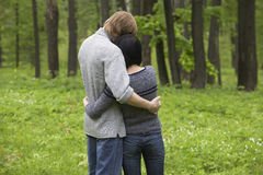 Young Couple Hugging In Forest Royalty Free Stock Images