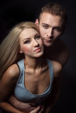 Young couple hugging. isolated shot. Young couple, men and women embrace. sensual love picture. couple dressed in jeans, a man's naked torso, a women gray shirt Stock Photography
