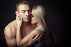 Young couple hugging. isolated shot. Young couple, men and women embrace. sensual love picture. couple dressed in jeans, a man's naked torso, a women gray shirt Royalty Free Stock Photography