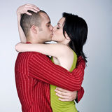 Young couple hugging kissing Royalty Free Stock Photos